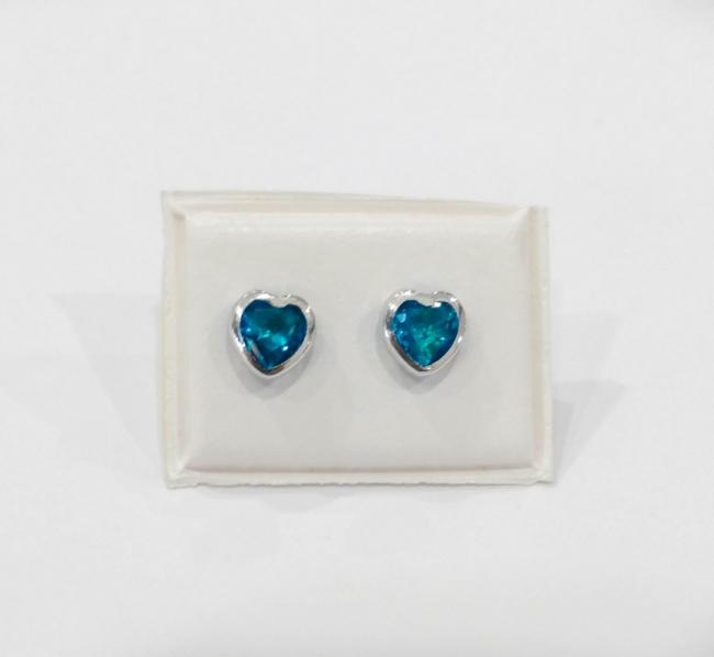 cc633ee25815 Aros oro blanco con cubic color turquesa en forma de corazón - Aros ...